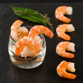 FROZEN Cooked and peeled tropical prawns FRESHPACK